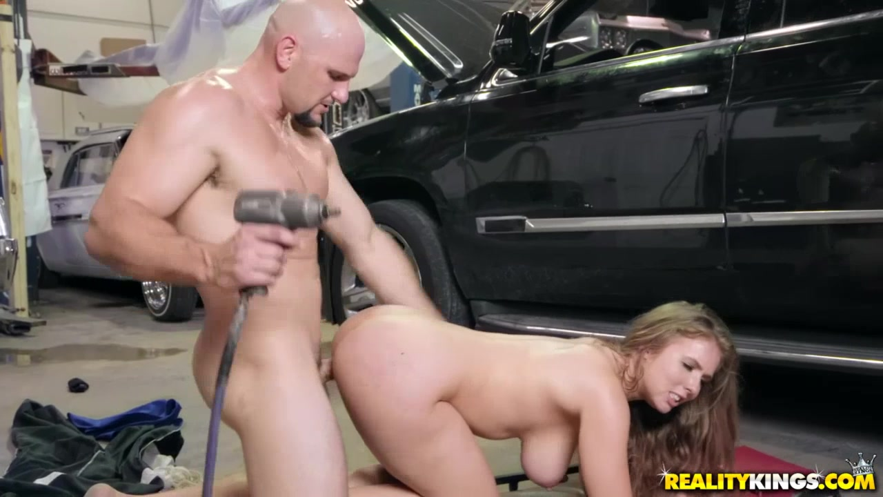 Strong stud lures hottie into the garage to fuck her there