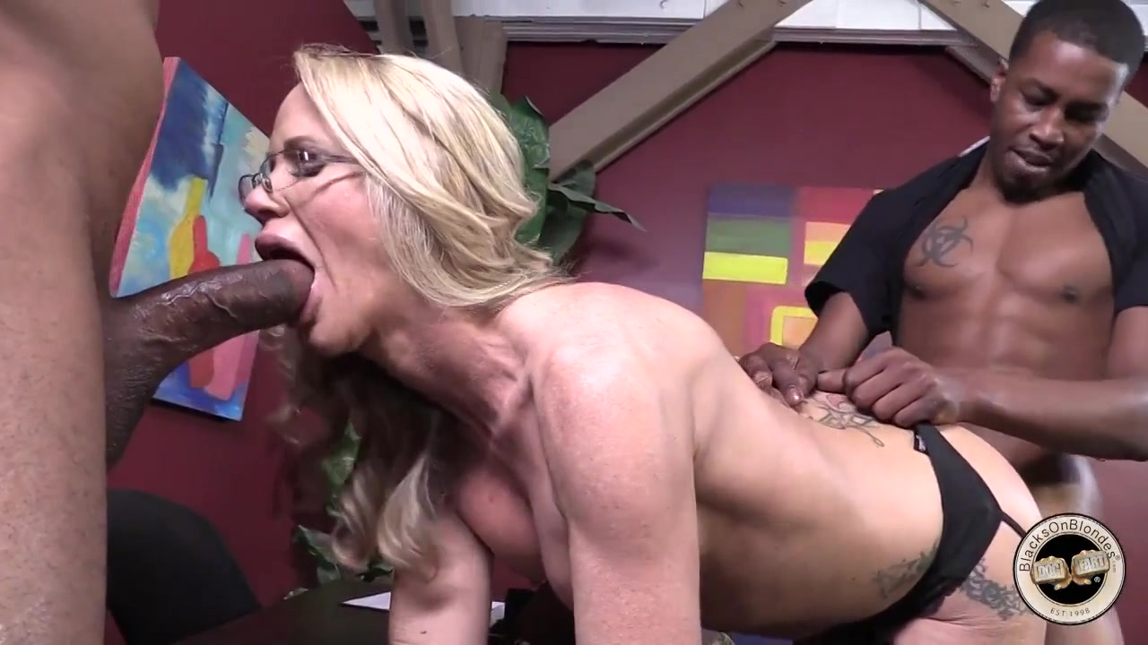 White blonde takes two big black cocks into her holes